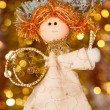 Christmas angel on fir tree branch — Stock Photo