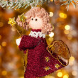 Christmas angel on fir tree branch — Stockfoto