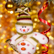 Christmas snowman on fir tree branch - Zdjęcie stockowe