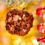 Christmas apple on fir tree branch — Stock Photo #15553513