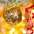 Christmas apple on fir tree branch - Foto Stock