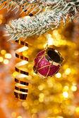 Christmas drum on fir tree branch — Stock Photo