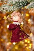 Christmas angel on fir tree branch — Stock Photo