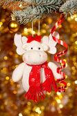 Christmas elk on fir tree branch — Stock Photo