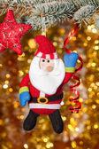 Christmas santa greeting on fir tree branch — Stock Photo