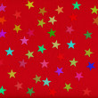 Holiday background. confetti in shape of star on red rough paper — Stock Photo