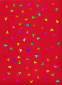 Holiday background. confetti in christmas tree form on a red rough paper — Photo