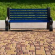 Bench in city park — Stock Photo