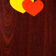 Two hearts on wooden background — Stock Photo