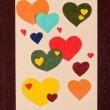 Card with hearts on wooden background — Stock Photo #16948071
