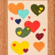 Card with hearts on wooden background — Stock Photo #16948137