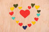Set of hearts on wooden background — Stock Photo