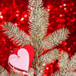 Royalty-Free Stock Photo: Two hearts on christmas fir tree branch