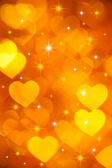 Golden hearts background — Stock Photo
