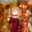 Christmas angel on fir tree branch - Stock Photo