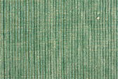 Green striped fabric background — Stock Photo