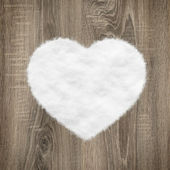Heart shape made of wood and snow — Stock Photo