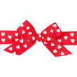 Red bow with hearts — Stock Photo