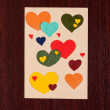 Card with hearts on wooden background — Stock Photo