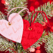 Hearts on fir tree branch - Stock Photo