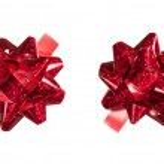Red bows made of shiny ribbon — Stock Photo #19119933