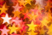 Red and golden stars background — Stock Photo