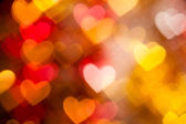 Red and golden hearts background — Stock Photo