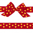 Red bow with yellow hearts and ribbon — Stock Photo
