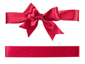 Big red bow made from silk ribbon — Stock Photo