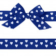Blue bow with hearts and ribbon — Stock Photo