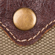 Stock Photo: Rivet on leather and fabric