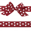 Brown bow with hearts and ribbon — Stock Photo