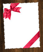 Blank paper sheet with red bow — Stock Photo