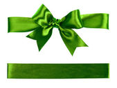 Big green bow made from silk ribbon — Stock Photo