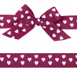 Purple bow with hearts and ribbon — Stock Photo