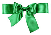 Green bow made from silk ribbon — Stock Photo