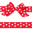 Red bow with hearts and ribbon — Stock Photo