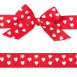 Red bow with hearts and ribbon - Stock Photo