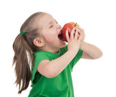 Girl eat apple on white — Stock Photo