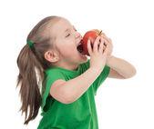 Girl eat apple on white — Stock Photo