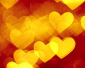 Red and golden hearts boke background — Photo