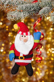 Christmas santa greeting on fir tree branch — Photo