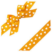 Yellow bow with hearts and ribbon — Stock Photo