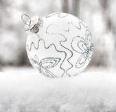 Christmas ball on snow — Stock Photo
