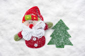 Father frost and christmas tree toys at snow — Stock Photo