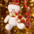 Christmas snowman on fir tree branch — Stock Photo