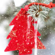 Christmas tree toy in snowfall with icicle — Stock Photo #31579945