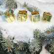 Stock Photo: Gift boxes on winter tree with snowfall