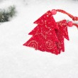 Christmas tree toy in snowfall — Stock Photo #31582705