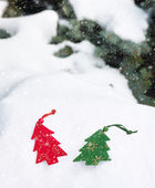 Christmas tree toy in snowfall — Stock Photo